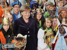 Fr. Merkel Empfängt Sternsinger